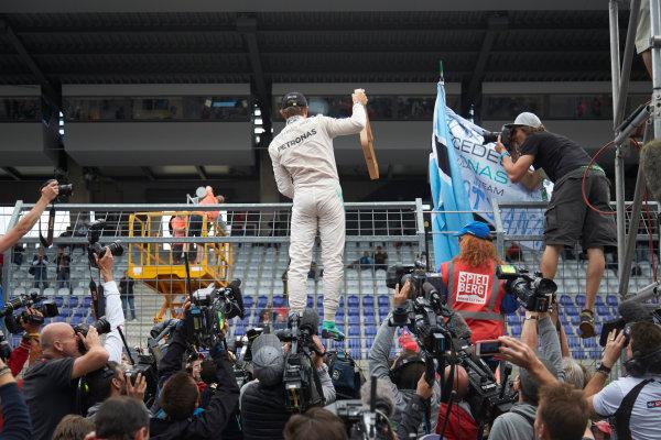 Red Bull Ring, Spielberg, Austria. Sunday 21 June 2015. Nico Rosberg, Mercedes AMG, 1st Position, celebrates with fans. World Copyright: Steve Etherington/LAT Photographic. ref: Digital Image SNE14937
