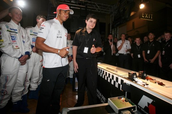Lewis Hamilton (GBR) McLaren tries his hand at racing one of the competing machines. F1 in Schools World Championships 2009, London, England, 17 September 2009.