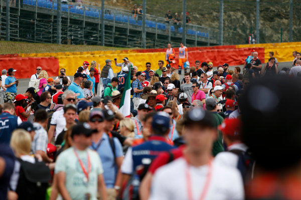 Spa-Francorchamps, Spa, Belgium. Sunday 23 August 2015. Fans invade the circuit after the race. World Copyright: Zak Mauger/LAT Photographic. ref: Digital Image _L0U5492