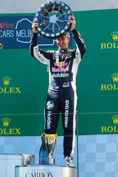 Jamie Whincup, Triple Eight Race Engineering Holden, with his trophy.