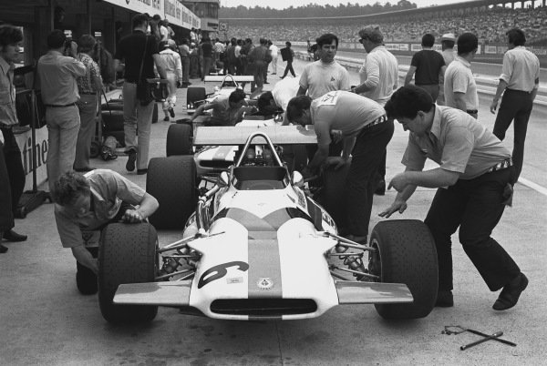 1970 German Grand Prix. Hockenheim, Germany. 31st July - 2nd August 1970. Pedro Rodriguez (B.R.M. P153), retired, has a wheel change during practice, action.  World Copyright: LAT Photographic. Ref: 3235 - 16.
