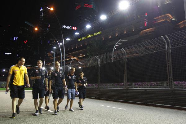 Marina Bay Circuit, Singapore. Thursday 19th September 2013. Sebastian Vettel, Red Bull Racing walks the track with his team. World Copyright: Andy Hone/LAT Photographic. ref: Digital Image HONY9123