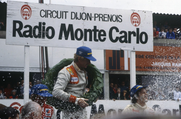 Jean-Pierre Jabouille celebrates victory with Gilles Villeneuve, 2nd position, and René Arnoux, 3rd position.
