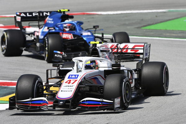 Mick Schumacher, Haas VF-21, leads Esteban Ocon, Alpine A521