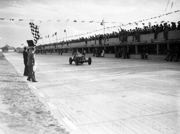 """""""B. Bira"""", ERA, crosses the line and takes the chequered flag."""