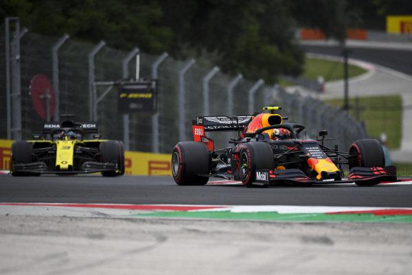 Pierre Gasly, Red Bull Racing RB15, leads Daniel Ricciardo, Renault R.S.19