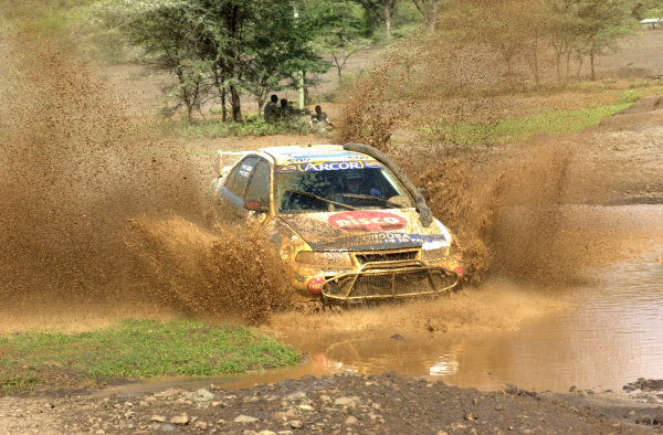 2001 World Rally Championship.Nairobi, Kenya. July 20-22, 2001Pozzo traverses a river in section 8.Photo: Ralph Hardwick/LAT