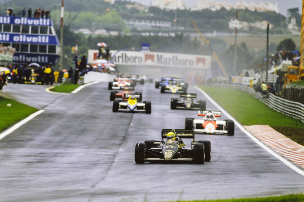 Ayrton Senna, Lotus 97T Renault, leads Alain Prost, McLaren MP4-2B TAG, Keke Rosberg, Williams FW10 Honda, and Elio de Angelis, Lotus 97T Renault, on the formation lap.