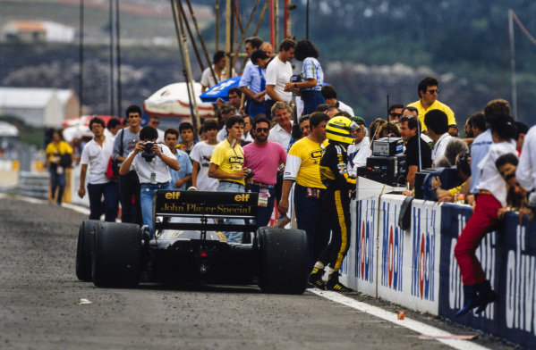 Ayrton Senna gets out of his Lotus 98T Renault, after running out of fuel.