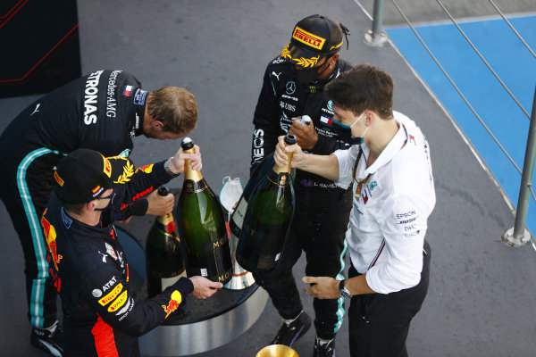 Max Verstappen, Red Bull Racing, 2nd position, Valtteri Bottas, Mercedes-AMG Petronas F1, 3rd position, and Lewis Hamilton, Mercedes-AMG Petronas F1, 1st position, on the podium with the Mercedes trophy delegate