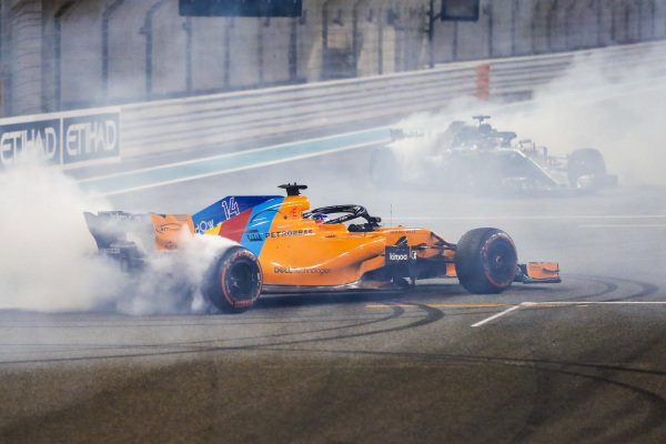 Fernando Alonso, McLaren MCL33, and Lewis Hamilton, Mercedes AMG F1 W09 EQ Power+, perform donuts after the race