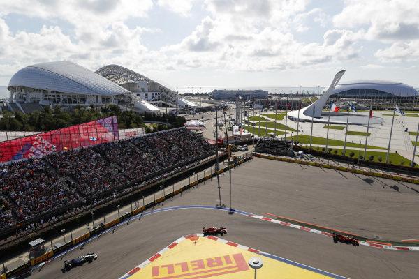 Sebastian Vettel, Ferrari SF90, leads Charles Leclerc, Ferrari SF90 and Lewis Hamilton, Mercedes AMG F1 W10