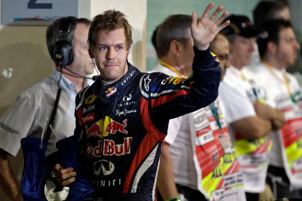 Yas Marina Circuit, Abu Dhabi, United Arab Emirates12th November 2011.Sebastian Vettel, Red Bull Racing RB7 Renault, celebrates pole in Parc Ferme. Portrait. World Copyright:Glenn Dunbar/LAT Photographic ref: Digital Image _G7C4547