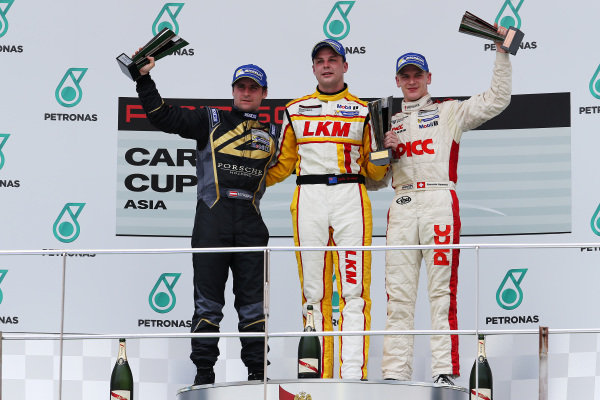 Podium (L to R): Martin Ragginger (AUT) Team Porsche Holding, race winner Earl Bamber (NZL) LKM Racing Team and Alexandre Imperatori (HKG) PICC Team StarChase. Porsche Carrera Cup Asia, Sepang, Malaysia, 28-30 March 2014.